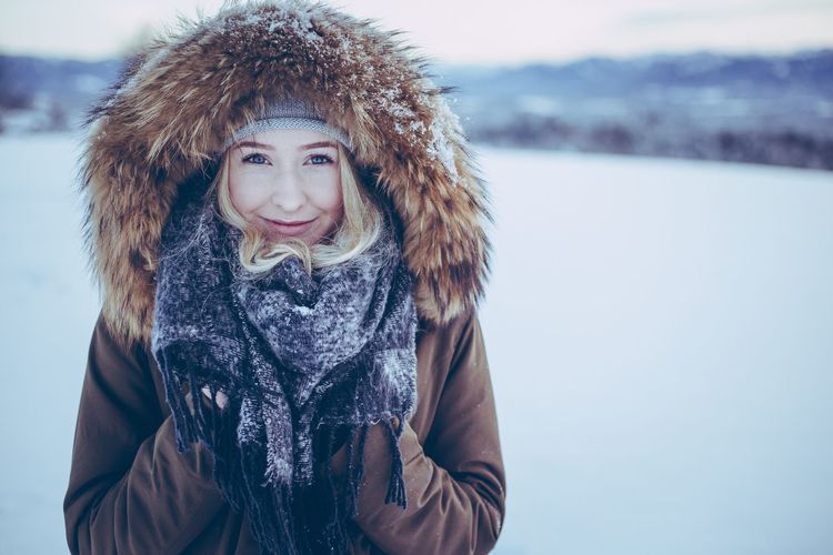 Winter Cold Temperature Snow Warm Clothing Scarf Outdoors Real People Looking At Camera Weather Portrait Lifestyles Beautiful Woman Smiling One Person Happiness Young Adult Young Women Women Day Nature