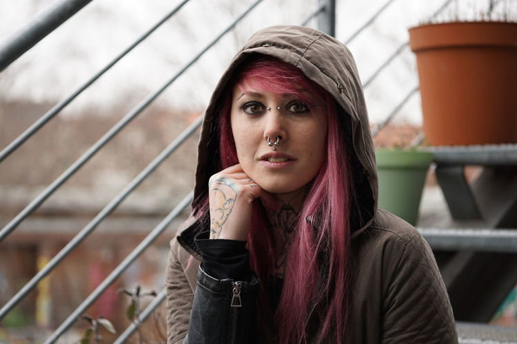 Portrait Of Woman With Pink Hair And Hooded Shirt
