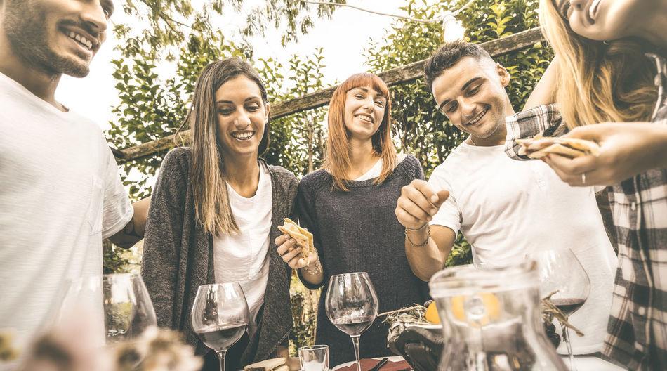 Friends Eating Food At Vineyard