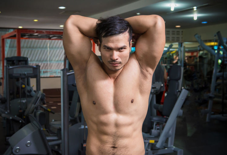personal fitness trainer show his muscles or Strong bald bodybuilder with six pack Abdominal Muscle Adult Athlete Chest Determination Effort Exercising Gym Healthy Lifestyle Human Body Part Human Muscle Indoors  Lifestyles Masculinity Men Muscular Build One Person Shirtless Sport Sports Training Strength Vitality Weight Training  Young Adult Young Men