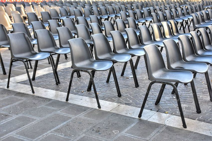 Streetphotography Street Square Urban Blackandwhite Seat Chair Arrangement In A Row Furniture Theater Outdoor Cafe Street Scene Street Scene Paved