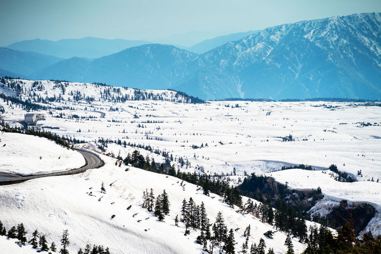 Ice-covered mountain roads in late winter. Ice Nature Landscape River Snow Water Winter Cold Sky Tree Forest Mountain Season  Travel White View Covered Beautiful Outdoor Frost Background Blue Frozen Snowy Wood Trees Natural Scenery Tourism Scenic Vacation Environment Scene Peak Park Valley Lake Wild Weather Beauty Pine Mountains Siberia Nobody ASIA Stream Hill Outdoors Snowflake December