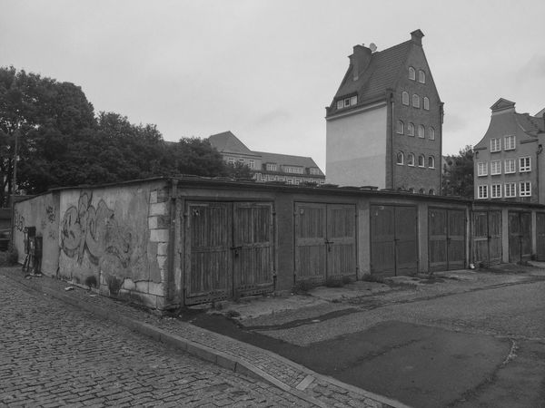 Backyard Bliss - Gdańsk 10 June 2017 ( IPhone 6+ ) Architecture Backgrounds Backyard Bnw Bnw_collection Building Exterior Built Structure Garages Geometric Shapes Leading Lines No People Outdoors Sky Vintage