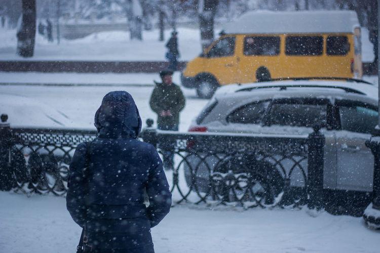 Woman on snow covered urban street