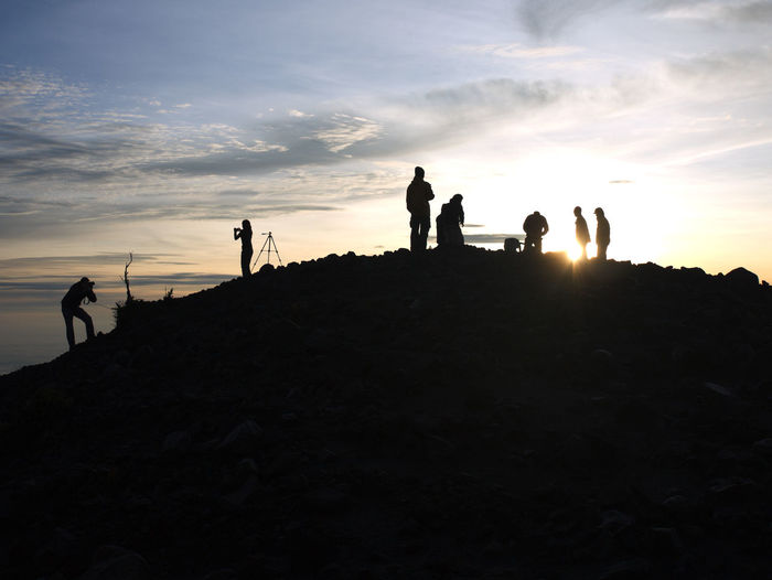 Sunrise at the peak after a nightlong trek Trekking Beauty In Nature Cloud - Sky Day Friendship Hiking Large Group Of People Leisure Activity Lifestyles Nature Outdoors People Real People Scenics Silhouette Sky Standing Sunrise At Mountain Top Sunset Togetherness Vacations
