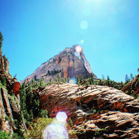 Clear Sky Sunlight Tranquil Scene Tranquility Blue Sunny Scenics Solitude Mountain Lens Flare Nature Beauty In Nature Rock Formation Travel Destinations Physical Geography Outdoors Rock Remote Day Tourism Zion National Park Canon Canonphotography Nature Canont3i