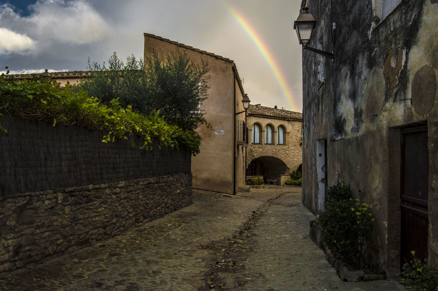 Peratallada Arch Architecture Building Built Structure Cloud Cloud - Sky Cloudy Day Diminishing Perspective Empty Girona Historic Narrow No People Outdoors Peratallada Rainbow Residential Building Sky The Way Forward Town Vanishing Point Walkway
