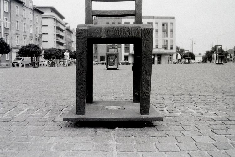 Analog Analogue Photography Black & White Blackandwhite Blackandwhite Photography Buy Film Not Megapixels Chair City City Street Contemporary Art Film Photography Fomapan Fomapan100 Ghetto Memory Monument Paving Stone Pentacon Perspective Praktica Praktica Mtl 5b Square Street Vanishing Point
