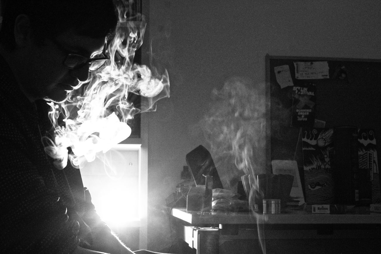 burning, flame, smoke - physical structure, heat - temperature, men, real people, night, indoors, risk, occupation, one person, close-up, people
