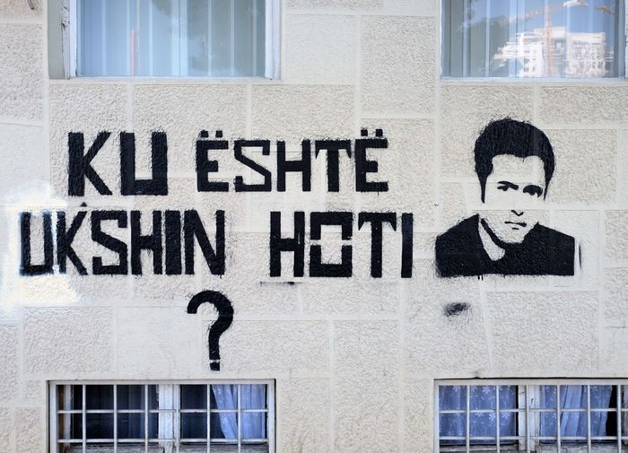 Ukshin Hoti (1943–1999) was a Kosovo Albanian philosopher and activist. Hoti was a professor of international law and later philosophy at the University of Pristina and founder of UNIKOMB, a political party of Kosovo. Since 1982 he had been arrested several times by Yugoslav authorities. In 1994 he was convicted to five years in the Dubrava prison. In May 1999, when his sentence ended and he was to be released, guards of the prison relocated him.[1] His whereabouts are unknown and many human rights activists consider him dead. Graffiti Pristina Kosovo Ukshin Hoti Philosopher Tag