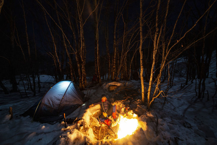 Cold Winter ❄⛄ Cold Winter Bushcraft Outdoors Hiking Hikingadventures Mountain Mountain Peak Camping Campinglife Beauty In Nature EyeEm Best Shots Nature Nature_collection Nature Photography Hiking Adventures Snow Snowing Fire Night Forest Photography Winter Forest Camping Life EyEm Selects Flame Campfire