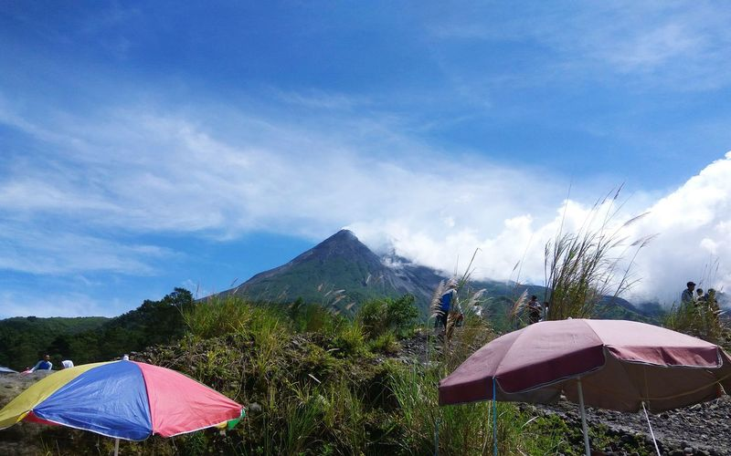 mount of Merapi Parks Nature Outdoor Play Equipment Morning Family Happy Sky And Clouds Traveling EyeEm Nature Lover Umbrellas Grass Area Rock Vulcano Vulcanic Landscape EyeEm Nature Lover EyeEm Is Here EyeEm Indonesia Plant Life Mountain View Rocks Naturelovers