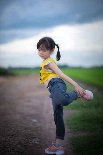 Full length of boy running on road