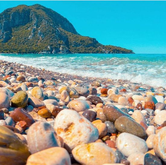Beach Sea Water Blue Sky Vacations Nature Beauty In Nature No People Mountain Outdoors Sand Day Horizon Over Water Pebble Beach