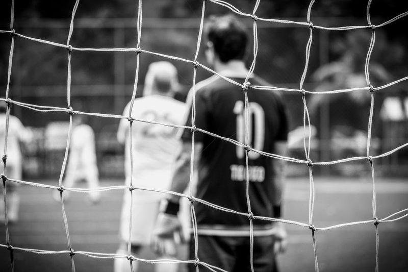 Players on field seen through net