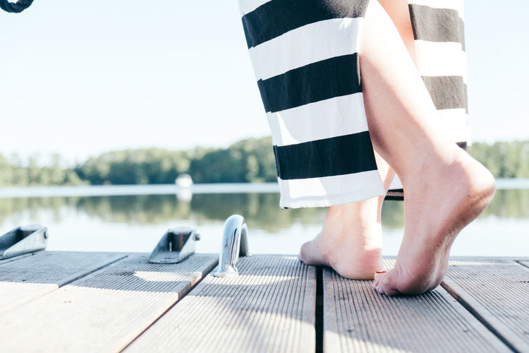 Close-up Day Feet Human Body Part Human Leg Lake Leisure Activity Lifestyles Low Section Men Nature Nature Nautical Vessel One Person Outdoors People Real People Sky Water Waterfront Women