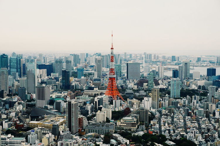 Tokyo tower in city against clear sky
