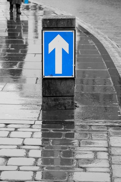 9627 Architecture Black & White Black And White Blackandwhite Blue Blue Eyes Close-up Cobblestone Communication Day Human Representation No People One Way One Way Sign One Way Street Outdoors Pathway Person Raining Reflection Road Sign Walking Way Ahead Wet Street