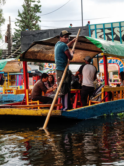 People on boat in canal