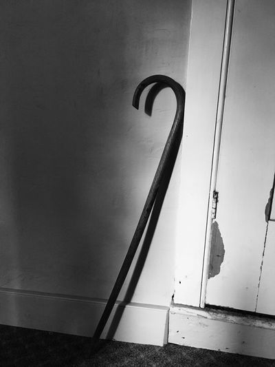 It stands alone Blackandwhite Still Life Cane Leaning Blackandwhitephotography Creative Light And Shadow Objects Handicap Wall Assistant Standalone Walkingstick Hurt Trim Vintage Stuff Helpme