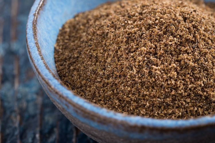 Close-up of garam masala in bowl on table