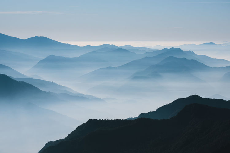 Silhouette of mountains looking like sheets of papers during sunrise at uttarakhand, india