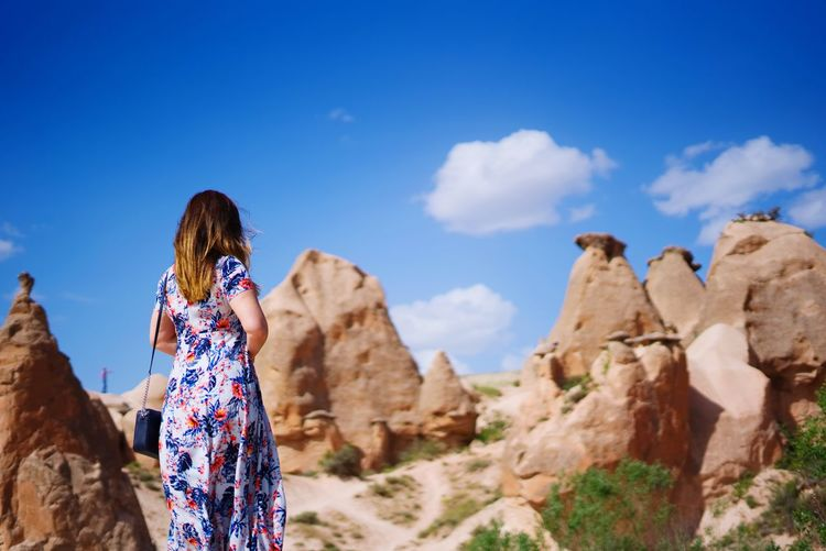 Beautiful girl in cappadocia SONY A7III Turkey Kapadokya Cappadocia Fairy Chimneys Knycl Sky One Person Women Leisure Activity Rock Rock - Object Cloud - Sky Rock Formation Lifestyles Real People Solid Standing Adult Nature Rear View Casual Clothing Hairstyle Beauty In Nature Day