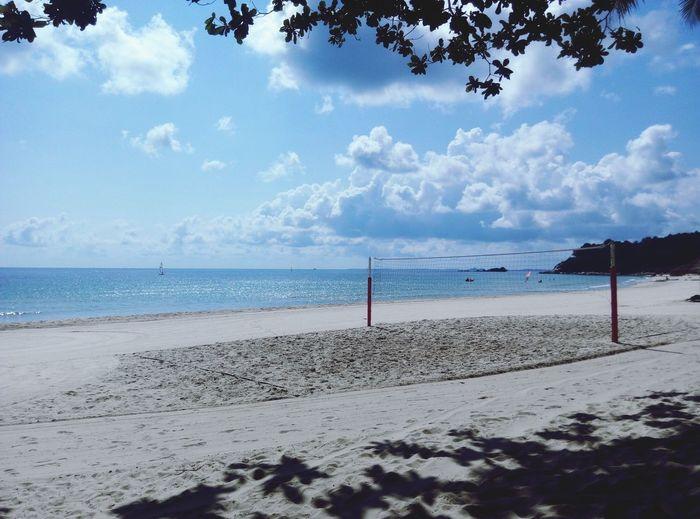 Beach volleyball net by sea against sky at bintan island