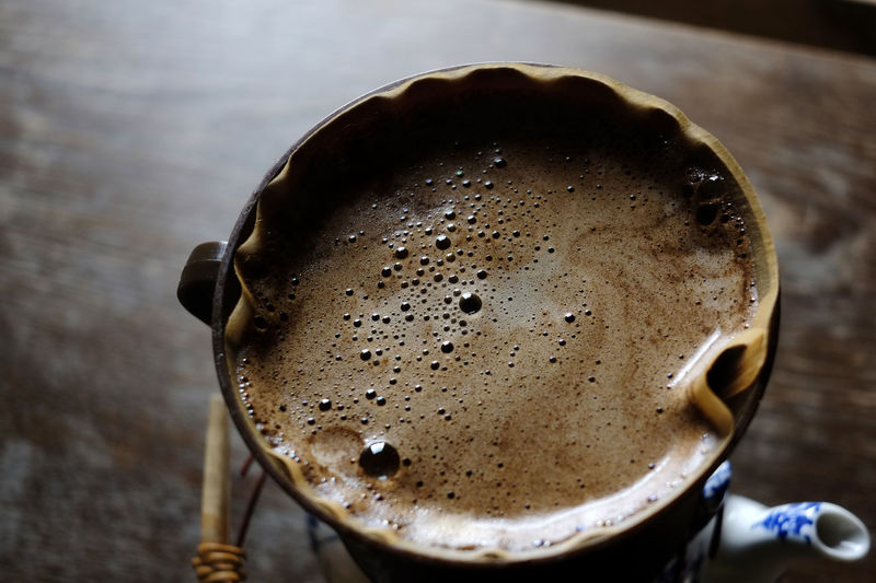 Close-up of coffee being filtered in cup