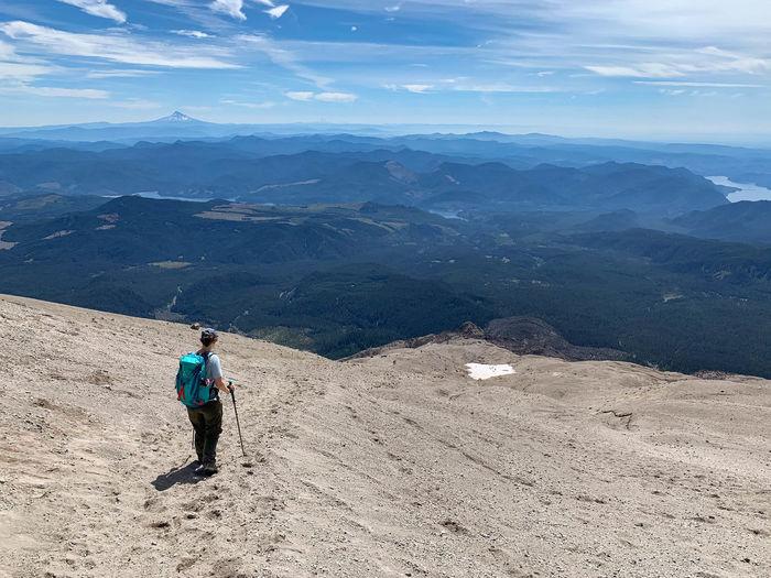 Full length of man walking on mountain against sky