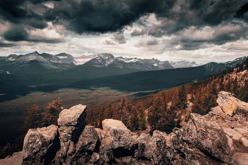 Moody Canada Moody Mountain Sky Cloud - Sky Scenics - Nature Environment Beauty In Nature Landscape Non-urban Scene Tranquility Travel Tranquil Scene Plant Travel Destinations Mountain Range Outdoors Coniferous Tree No People Land Nature Snow