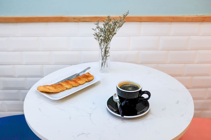 Americano Bakery Black Coffee Blue Wall Bread Bread Sticks  Brick Wall Coffee - Drink Coffee Cup Creama Day Desert Drink Food Food And Drink Freshness Homemade Bread Indoors  Knife No People Plate Ready-to-eat Refreshment Table White Wall