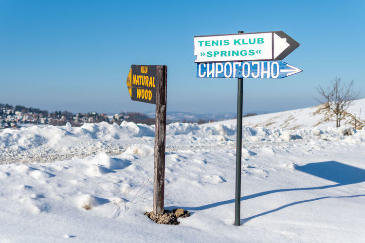 Snow Cold Temperature Sign Winter Communication Text Western Script Nature Day Road Sign Guidance Information Sky No People Capital Letter Information Sign Road Blue Land Snowcapped Mountain