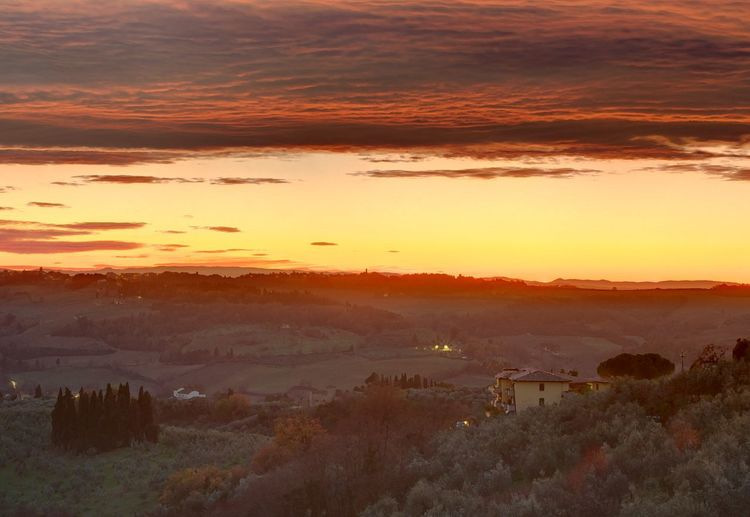 Reddish sunset on the Chianti hills Sunset Sky Beauty In Nature Scenics - Nature Cloud - Sky Orange Color Tranquil Scene Environment Landscape Tranquility No People Nature Plant Idyllic Tree Architecture Building Exterior Outdoors Built Structure Non-urban Scene Cityscape Reddish Tuscany Hills FAR AWAY