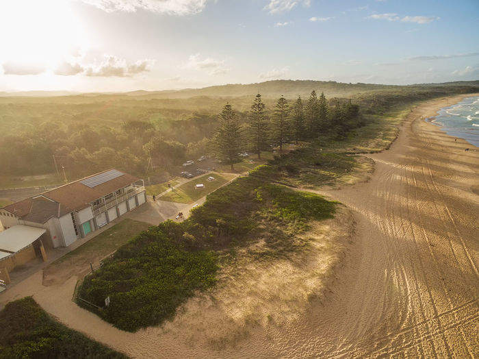 Aerial view of beautiful ocean coastline, sandy beach, and trees casting long shadows at sunset Australia Coastline Drone  Inlet New South Wales  Panorama Panoramic Vivid Colours  Aerial Aerial View Architecture Beach Beauty In Nature Building Building Exterior Built Structure Camden Inlet Cloud - Sky Day Drone Photography Environment High Angle View Land Landscape Nature No People Ocean Outdoors Plant Scenics Scenics - Nature Sky Sunlight Sunset Tranquil Scene Tranquility Tree