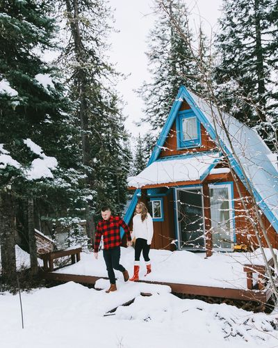 Tis the season. Winter Snow Cold Temperature Two People Tree Full Length Togetherness Vacations Nature Leisure Activity Enjoyment Men Day Adult Bonding Love Pine Tree People Outdoors Adults Only