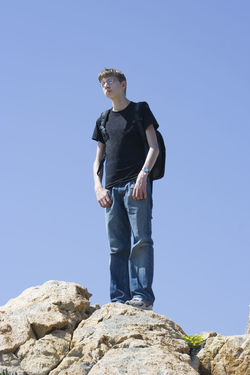 teen on mountain top Adventure Clear Sky Cliff Côte D'Azur Exploration Exploring Full Length Hiking Hiking Adventures Individuality Low Angle View Mountain Mountain Peak Nature On Top Of One Boy Only One Teenage Boy Only Outdoors Rock Rock Formation Success Teen Teenage Boy Teenager