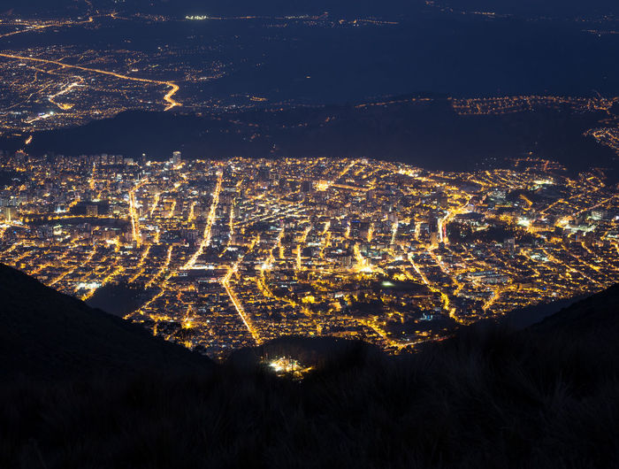 Quito, Ecuador at night from the teleferico. Aerial Shot Teleferico Aerial View Architecture Beauty In Nature Building Exterior Built Structure City City Lights Cityscape Environment High Angle View Illuminated Land Landscape Mountain Mountain Range Nature Night No People Outdoors Scenics - Nature South America Street Travel Destinations