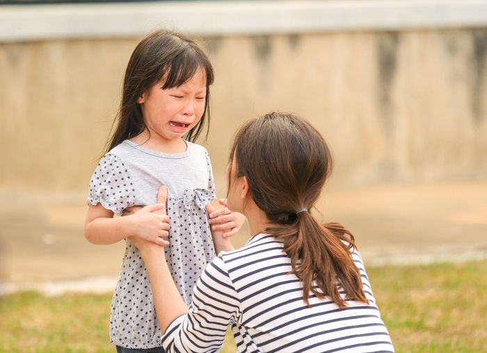 Bonding Casual Clothing Child Childhood Daughter Emotion Family Family With One Child Females Focus On Foreground Girls Hair Hairstyle Innocence Leisure Activity Mother Outdoors Positive Emotion Real People Togetherness Women