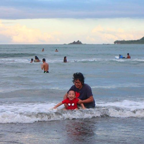 enjoying the waves in Baler Baler Aurora Surfing Waves Beach Child Wave Sea People Adult Sand Vacations Togetherness Outdoors Smiling Sky Portrait