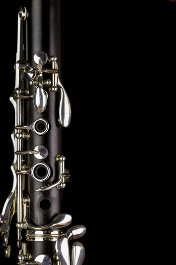 Music Instrument Clarinet, Clarinet Isolated on black Musical Instrument Music Arts Culture And Entertainment Metal Studio Shot Copy Space Close-up Indoors  Brass Instrument  Black Background Gold Colored Single Object Brass Still Life No People Wind Instrument Shiny Cut Out Musical Equipment Trumpet Silver Colored Ornate Chrome