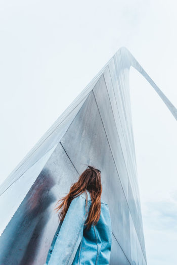 Low angle view of woman against gateway arch