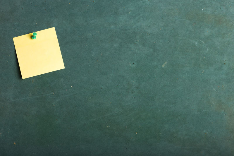 Adhesive Note On Green Board