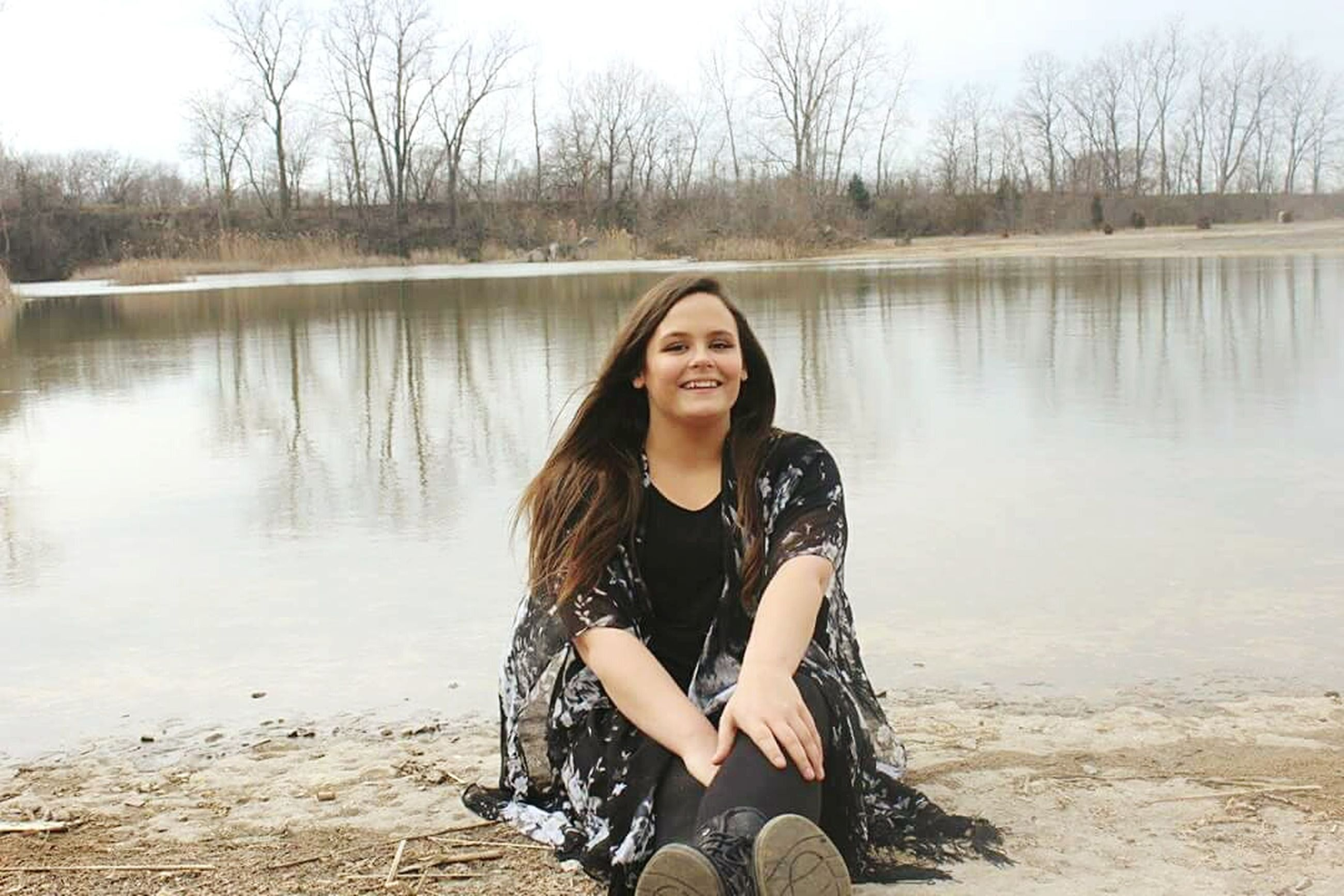 young adult, lifestyles, water, looking at camera, portrait, person, tree, leisure activity, lake, young women, front view, casual clothing, smiling, sitting, standing, sunglasses, reflection, river