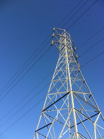 On the grid EyeEm Selects Sky Low Angle View Cable Blue Fuel And Power Generation Connection Electricity  Clear Sky Power Supply No People Technology Electricity Pylon Metal Power Line  Built Structure Architecture Outdoors Tall - High Day