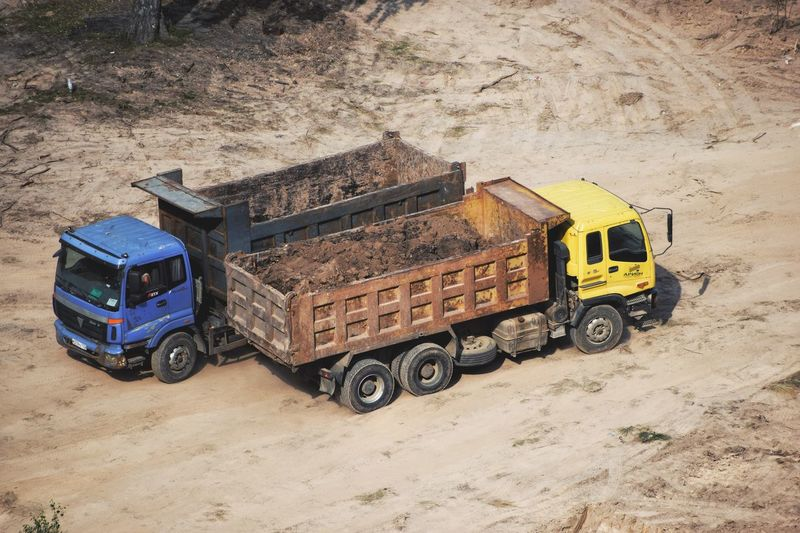 Construction site 🏗 From Above  Trucks Construction Machinery Construction Site Transportation Land Vehicle Mode Of Transportation Land Day Truck High Angle View Outdoors Commercial Land Vehicle No People Motor Vehicle Field Machinery Sand Industry Construction Industry Dirt