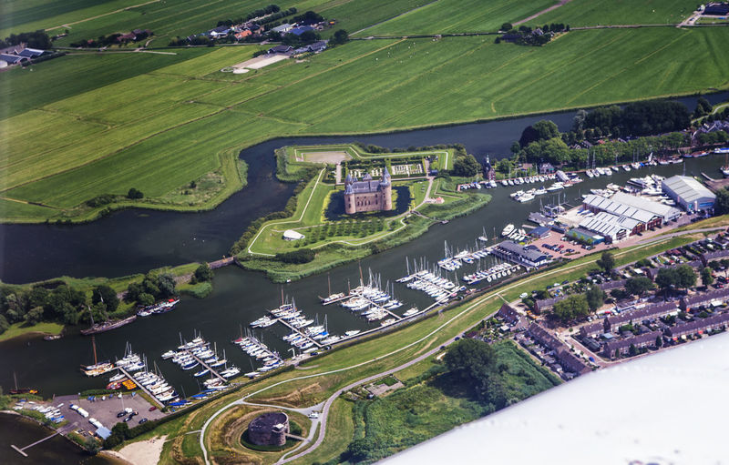 muiderslot, muiden, North Holland,holland, the netherlands Muiderslot The Netherlands Aerial View Architecture Building Building Exterior Built Structure Day Environment Field Grass Green Color High Angle View Holland House Land Landscape Muiden Nature No People Outdoors Plant Sport Transportation Water