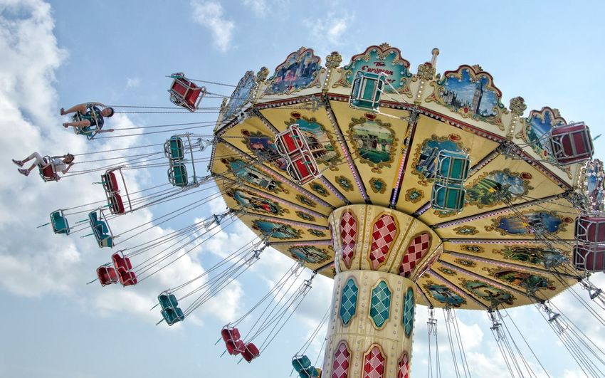 What A Feeling Excitement Merry Go Round Carnival Amusement Park Amusement Park Ride Sky Low Angle View Arts Culture And Entertainment Leisure Activity Group Of People Chain Swing Ride Enjoyment Cloud - Sky Outdoors Fun