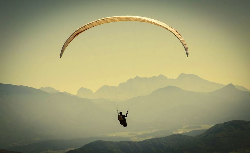Parachuting against rocky mountains