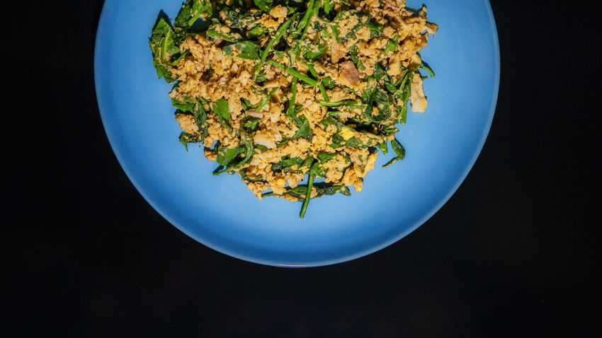 Gymnema sylvestre fried with egg and Oyster sauce Black Background Blue Close-up Day Food Food And Drink Freshness Fried Rice Healthy Eating High Angle View Indoors  No People Plate Ready-to-eat Studio Shot